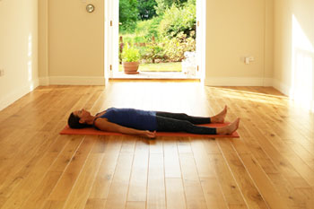 Savasana yoga position - The Coach House studio